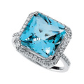 Ring Featuring a Fantasy Cut Swiss Blue Topaz encompassed by Diamonds